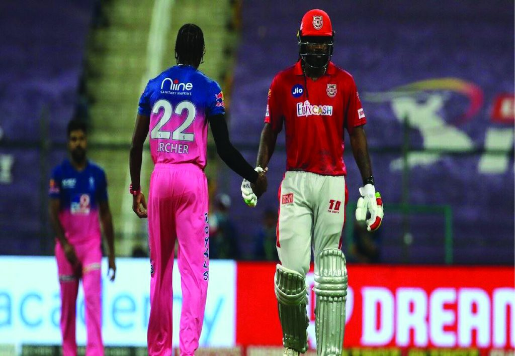 Chris Gayle and Jofra Archer shaking hands.